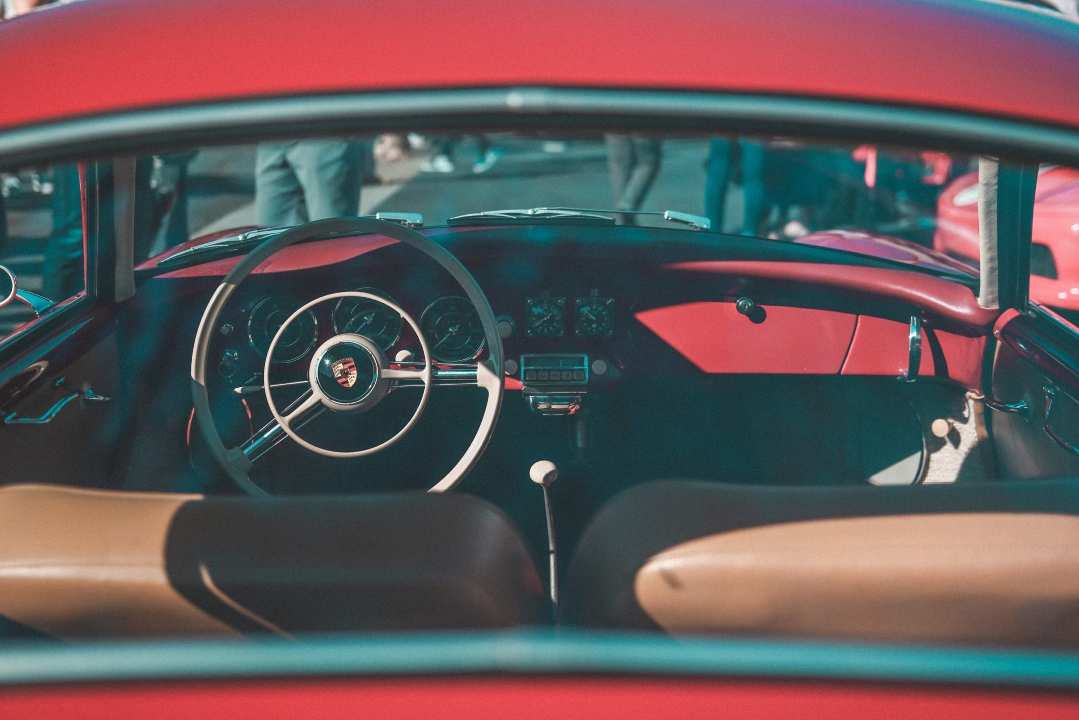 red and black Porsche vehicle interior