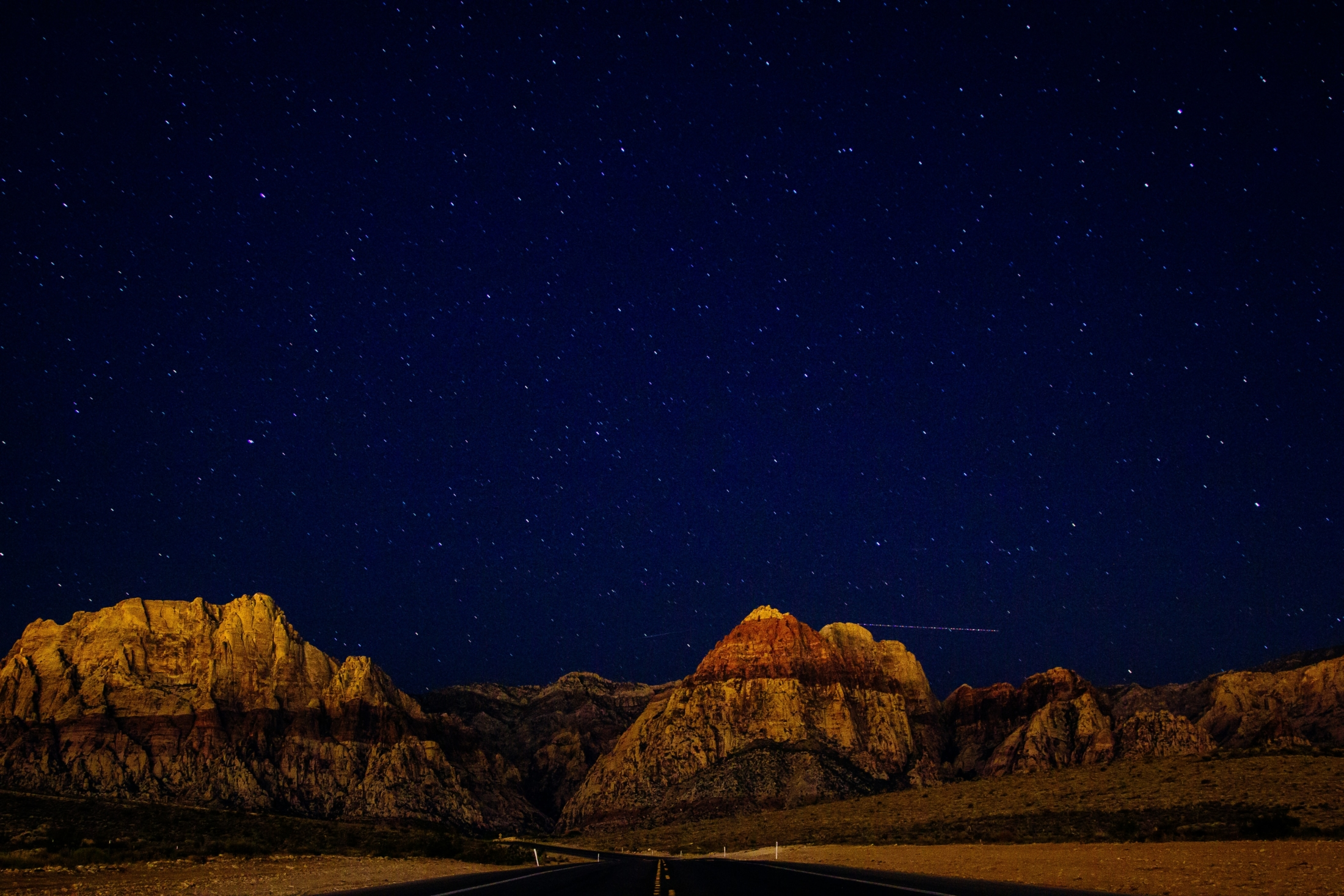 rocky mountain under star at night
